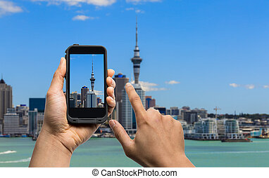 taking photo of Auckland