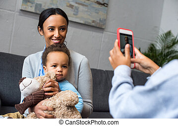 taking photo of mother and son
