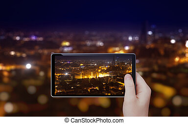 Taking photo of night city