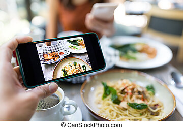 Taking photo on the food in restaurant