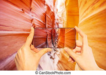 Taking photo with smartphone canyon in Utah, USA