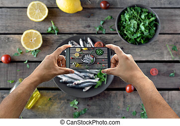 taking photograph of food with the smartphone