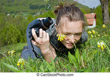 Taking photos - A young woman taking photos whit a compact ...