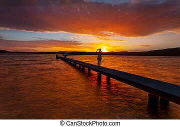 Taking photos of amazing sunsets from the jetty