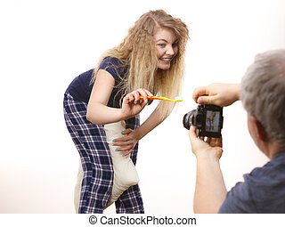Taking picture of woman brushing teeth