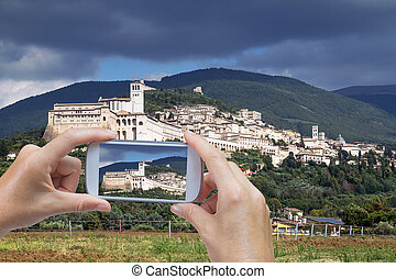 Taking pictures by smart phone in Assisi