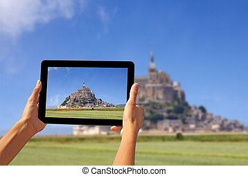 Taking pictures on a tablet - Girl taking pictures on a ...