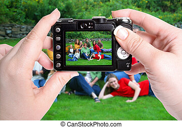 taking pictures - woman\\\'s hands hold camera taking a...