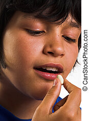 Boy taking a pill