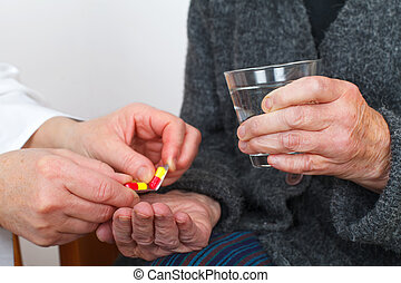Taking pills - Close up picture of a doctor hand giving...