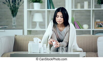 Taking Pills - Young woman having cold taking medication