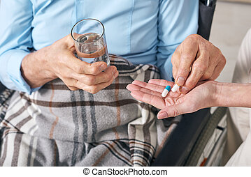 Taking pills under control of nurse