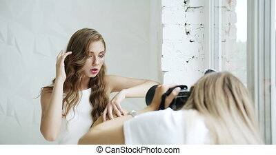 Taking Portrait Pictures - Young caucasian girl posing for...