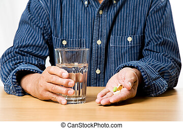 Taking prescription - A shot of a senior man taking medicine...