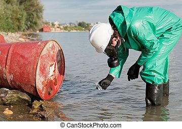 Taking sample of water - Environmentalist taking sample of...