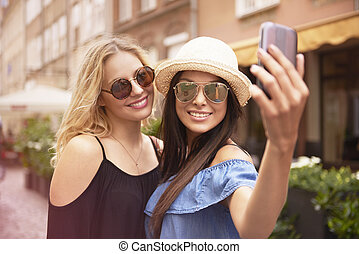 Taking selfie by two womens while traveling