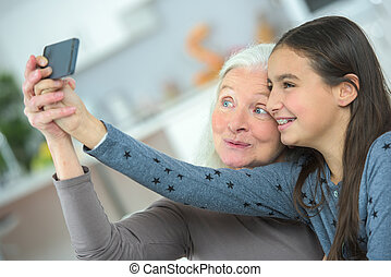 taking selfie with grandmother