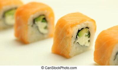 Taking sushi roll