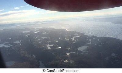 Taking the flight into Greenland from aerial view.
