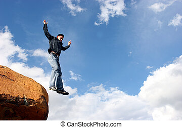 Man jumping from a rock