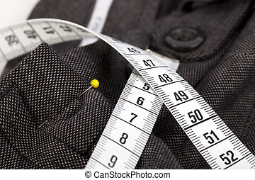 Taking Trousers In - Measuring tape and trousers about to be...