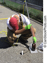 Taking underground water. - Young Field Engineer extracting...