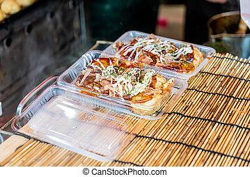 takoyaki in box at market in Japan