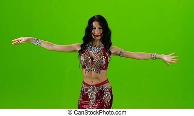 Talanted belly dancer in red dress. Green screen. Slow motion
