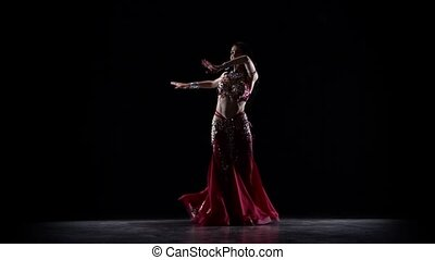 Talanted exotic belly dancer woman on dance. Black...