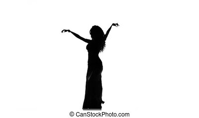 Talanted long-haired exotic belly dancer girl continue dance, silhouette, on white background