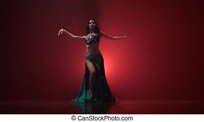 Talanted long haired exotic belly dancer girl go on dance ....