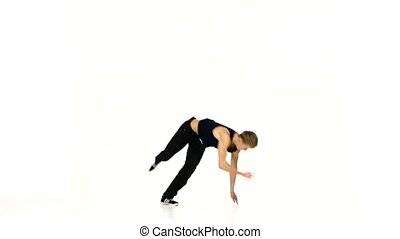 Talanted man continue dancing breakdance on white background, slow motion