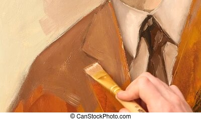 Talanted painter paints a picture of man`s jacket by oil paint brush with palette in his hand, on easel, white background