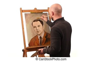 Talanted painter paints a picture of man by oil paint brush with palette in his hand, on brown easel, white background, slow motion