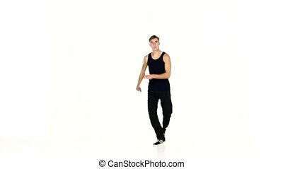 Talanted, stylish man continue dancing breakdance on white background, slow motion