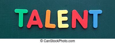 The term for talent in colorful letters on a blackboard.
