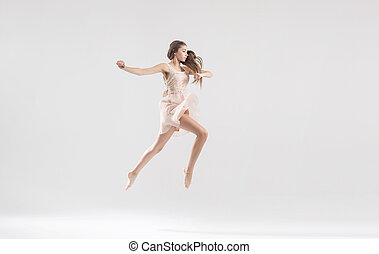 Talented ballet dancer in athletic jump - Young talented...
