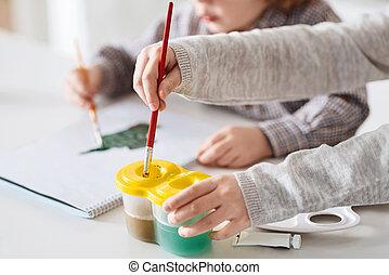 Talented creative children doing art together