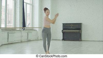Talented dancer performing modern dance in studio - Talented...