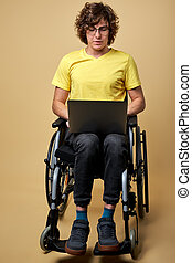 talented disabled man is typing message on laptop keyboard