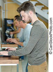 talented male student doing internet research