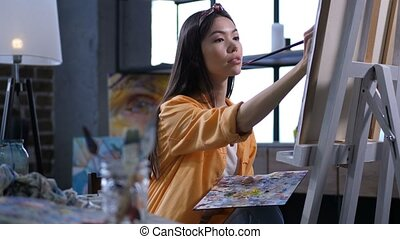 Talented painter making a painting at art studio - Talented...