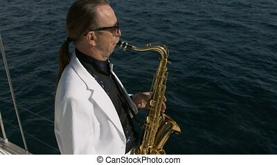 Talented saxophonist performs jazz on yacht