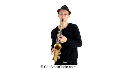 Talented saxophonist performs solo on saxophone. White background in studio