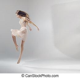 Talented pretty jumping ballet dancer