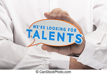 Man holding a comics bubble with the text we are looking for talents. Concept image for illustration of talent recruitment or job opportunities.