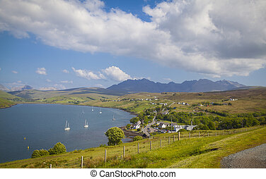Talisker Distillery and view of Black Cullins, Isle of Skye, Scotland