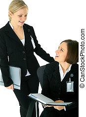 Talk Between Two Businesswoman