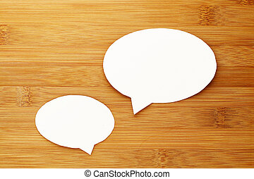 talk speech bubble on wood background