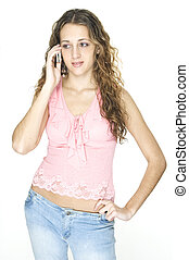 Talking - An attractive young female talks on a cellphone